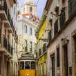 Narrow street in old Lisbon — Stock Photo #51480099