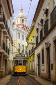 Narrow street in old Lisbon — Stock Photo