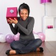 Mystery birthday gift for happy young girl at home — Stock Photo #5975422