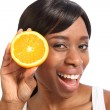 Happy smiling young black woman with orange fruit — Stock Photo #6166689