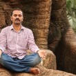 Close-up photo of a handsome indian executive doing meditation u — Stock Photo