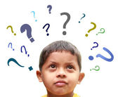 Young indian boy puzzled over many confusing questions without s — Stock Photo