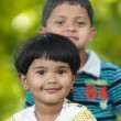 Foto de Stock  : Cute indian kids(brother and sister) having good time in a park