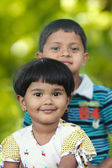 Cute indian kids(brother and sister) having good time in a park — Stock Photo