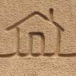 House(home) icon or sign drawing in beach sand - concept photo — Stock Photo