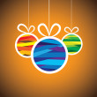 Stock Vector: Colorful xmas bauble balls on orange background- vector graphic