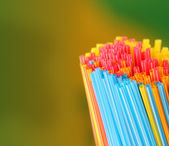 Green, yellow, blue, pink & red colored straws group — Stock Photo