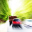 Vehicles or automobiles moving at very high speed on a highway — ストック写真
