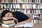 Sleeping on the books — Stock Photo