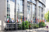 Flags in front of European Parliament towers - Brussels, Belgium — Stock Photo
