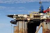 Old oil rig in harbor — Stock Photo