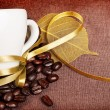 Coffee cup with yellow ribbon — Stock Photo