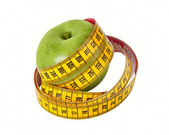 Measuring tape and apple — Stock Photo