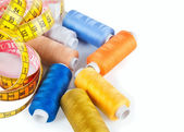Blue and yellow spools of thread — Stock Photo