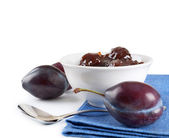 Ripe plums, jam and spoon — Stock Photo