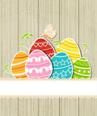 Wooden Easter background with eggs — Stock Vector