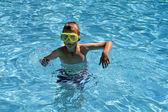 Teenage boy in the pool — Stock Photo