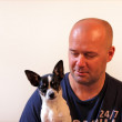 Man with pet chihuahua — Stock Photo #31342269