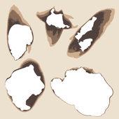 Burnt holes in paper — Stock Vector