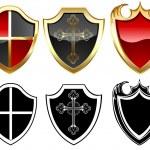 Three gold shield's — Stock Vector
