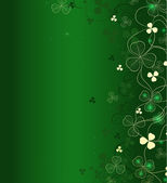Golden leaf clover on green background — Stock Vector