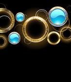 Hintergrund mit goldenen ringen — Stockvektor