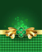 Gold bow with clover — Stock Vector