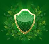 Grön sköld — Stockvektor