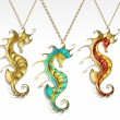Постер, плакат: Three gold seahorses