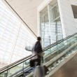 Blurred man going up the escalator - Stock Photo