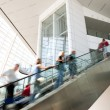 Blurred moving up the escalator - Stock Photo