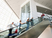 Blurred moving up the escalator — Stock Photo