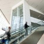 Airport figures up escalator — Stock Photo