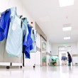 Hospital corridor with doctor protective uniforms — Stock Photo