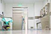 Blurred figure exiting hospital door — Stock Photo