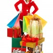 Female standing behind pile of christmas presents — Stock Photo