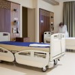 Staff fixing hospital bed — Stock Photo