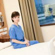 Female patient hospital bed - Stock Photo