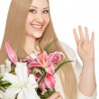 Smiling xxl woman holding flowers  — Stock Photo
