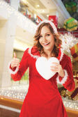 Santa woman christmas hearth thumbs up — Stock Photo