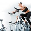 Woman veloargometer gim fitness — Stock Photo #42049409