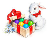 Easter rabbit bunny and box with eggs — Stock Photo