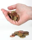 Некоторые монеты евро, упав с человеческой руки — Стоковое фото