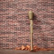 Stock Photo: Grenade launcher on brick wall