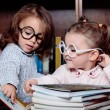 Girls in the library — Stock Photo