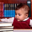 Baby in library — Stock Photo