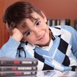 Stock Photo: Boy in library