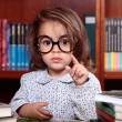 Girl in library — Stock Photo