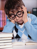 Bored kid studying — Foto Stock