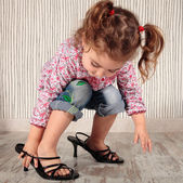 Girl and heels — Stock Photo